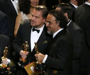 Director Alejandro Inarritu (R) and actor Leonardo DiCaprio hold their Oscars after the end of the awards ceremony at the 88th Academy Awards in Hollywood, California February 28, 2016. REUTERS/Mario Anzuoni