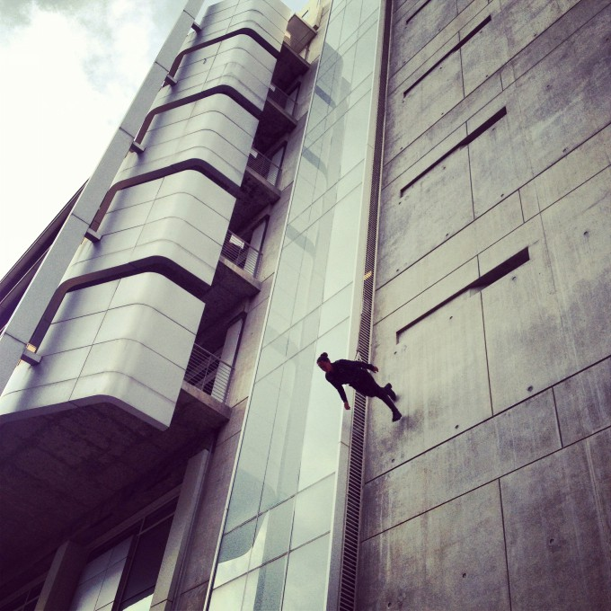 Trisha Brown Man Walking Down The Side of a Building